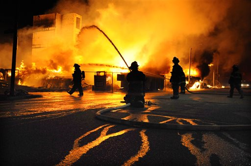 Baltimore firefighters battle a three-alarm fire Monday, April 27, 2015,  at a senior living facility under construction at Federal and Chester Streets in East Baltimore. It was unclear whether is was related to the ongoing riots but was one of...
