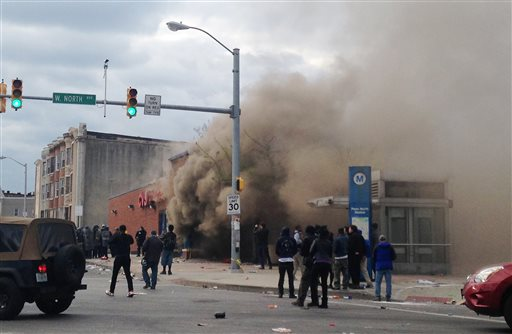 Smoke billows from a CVS Pharmacy store in  Baltimore on Monday, April 27, 2015. Demonstrators clashed with police after the funeral of Freddie Gray. Gray died from spinal injuries about a week after he was arrested and transported in a Baltimore...