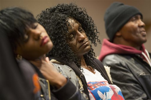 Family members of Freddie Gray, sister Fredricka Gray, left, mother Gloria Darden, center, and stepfather Richard Shipley listen during a news conference after a day of unrest following the funeral of Freddie Gray on Monday, April 27, 2015, in...