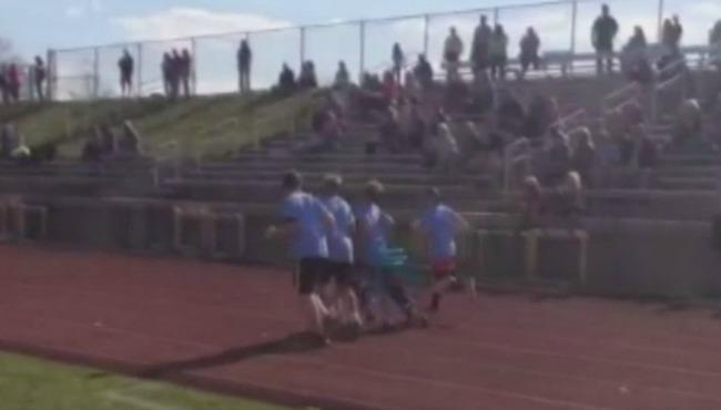 Forest Hills Northern Middle School students Noah Jacobs, Victor Santillan and Benjamin Hood run alongside their teammate Nathan VanDyken during_92100