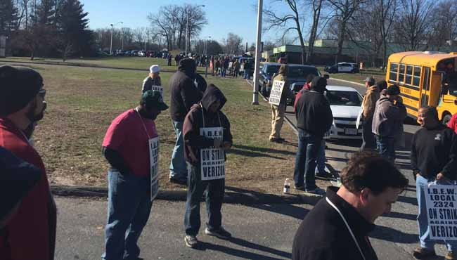 Picketers gathered on Brookdale Drive in Springfield on Wednesday morning, April 13, 2016.