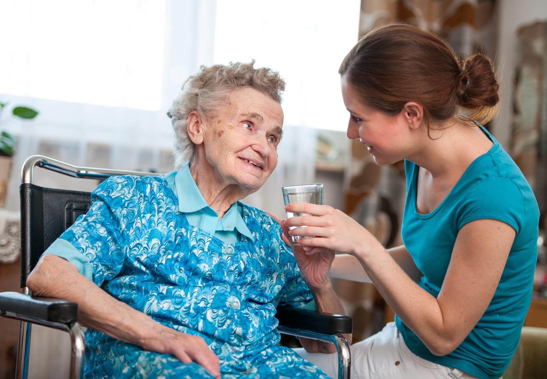 senior woman with home caregiver_508320