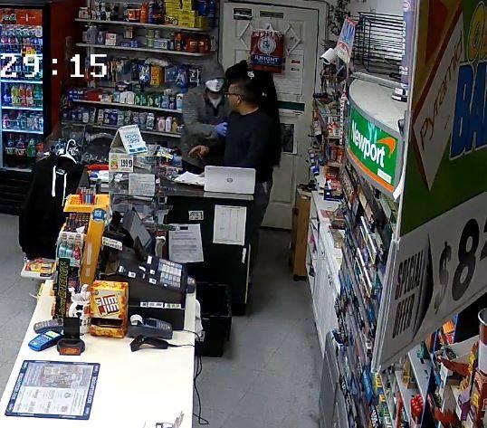 Surveillance image captured at the Basics Plus Mini Mart as it was robbed Sunday. Photo Courtesy: Chicopee Police.