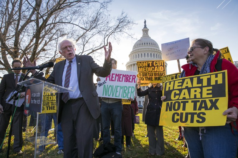 Sen. Bernie Sanders, I-Vt., joins protesters outside the Capitol as Republicans in the Senate work to pass their sweeping tax bill, a blend of generous tax cuts for businesses and more modest tax cuts for families and individuals, on Capitol Hill...