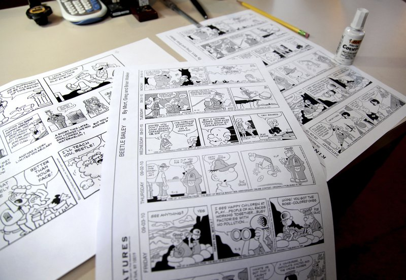 FILE - In this Aug. 16, 2010 file photo, Beetle Bailey comic strips that will be published in the coming weeks rest on a desk in the studio of creator Mort Walker in Stamford, Conn. On Saturday, Jan. 27, 2018, a family member said the comic strip...