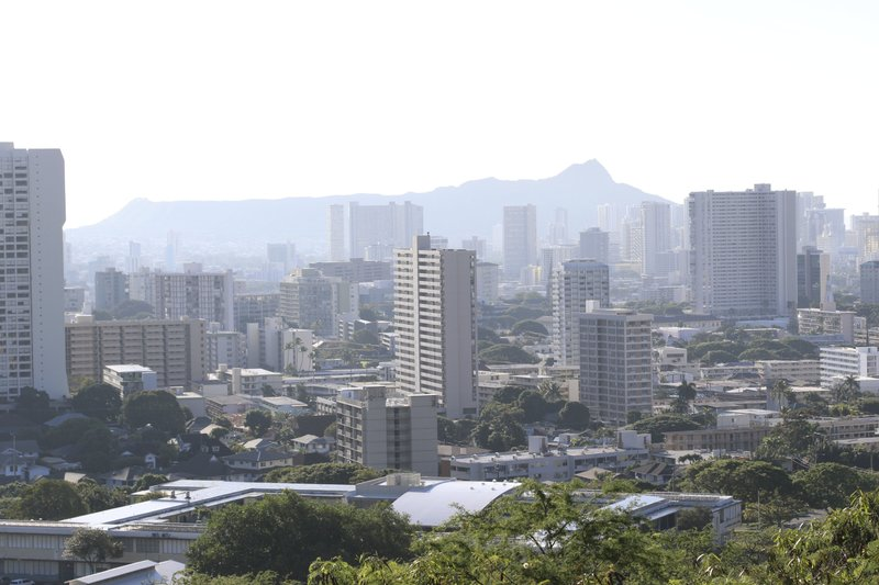 Diamond Head, an extinct volcanic crater, and high-rises are seen in Honolulu on Saturday, Jan. 13, 2018. A push alert that warned of an incoming ballistic missile to Hawaii and sent residents into a full-blown panic was a mistake, state emergency...