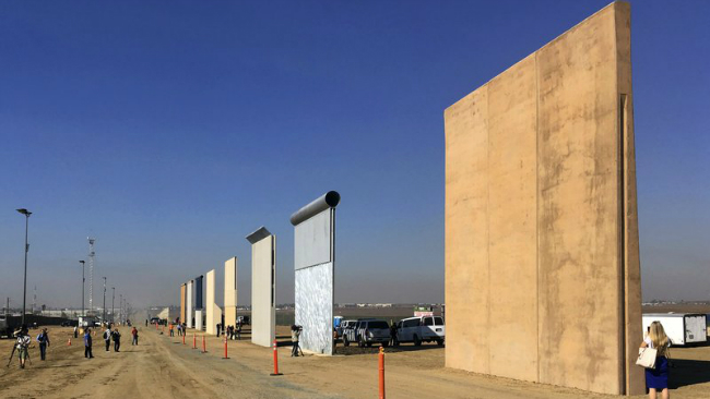 FILE - This Oct. 26, 2017 file photo shows prototypes of border walls in San Diego. The Trump administration has proposed spending $18 billion over 10 years to significantly extend the border wall with Mexico. The plan provides one of the most...