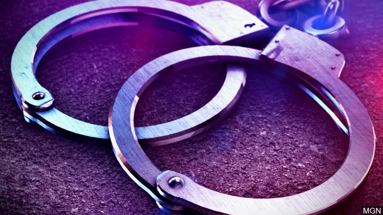police lights and handcuffs_1526207198243.jpg.jpg
