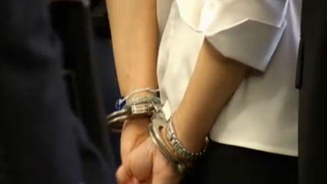 Cara Rintala in handcuffs_478007